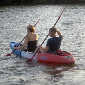 two students kayaking on town lake
